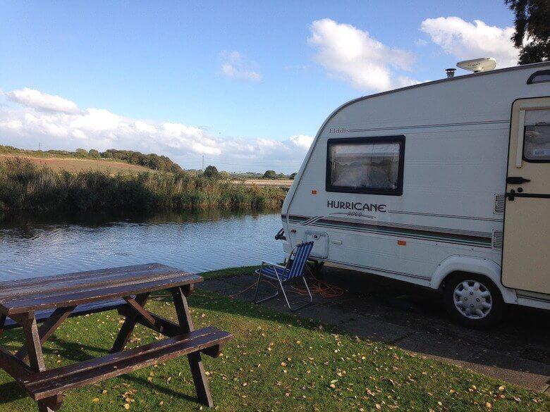caravan parked near a lake