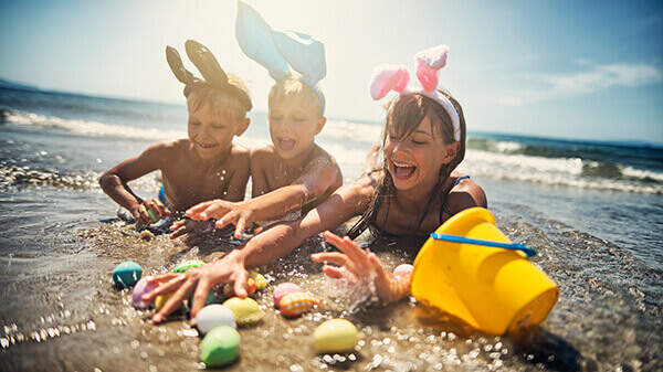 kids-playing-in-sea-during-summer-easter