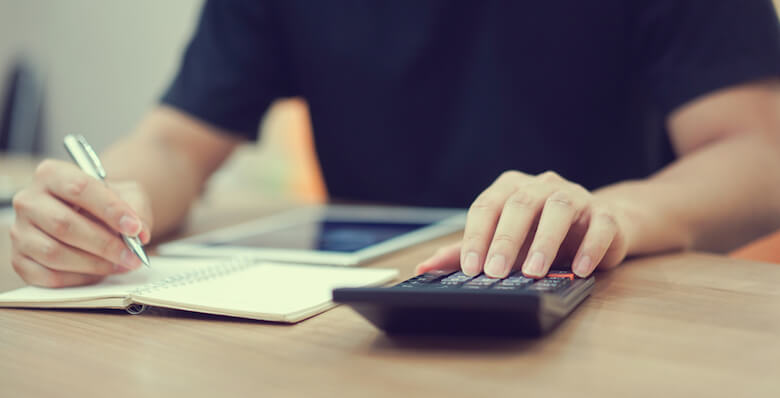 man calculating loans and bills