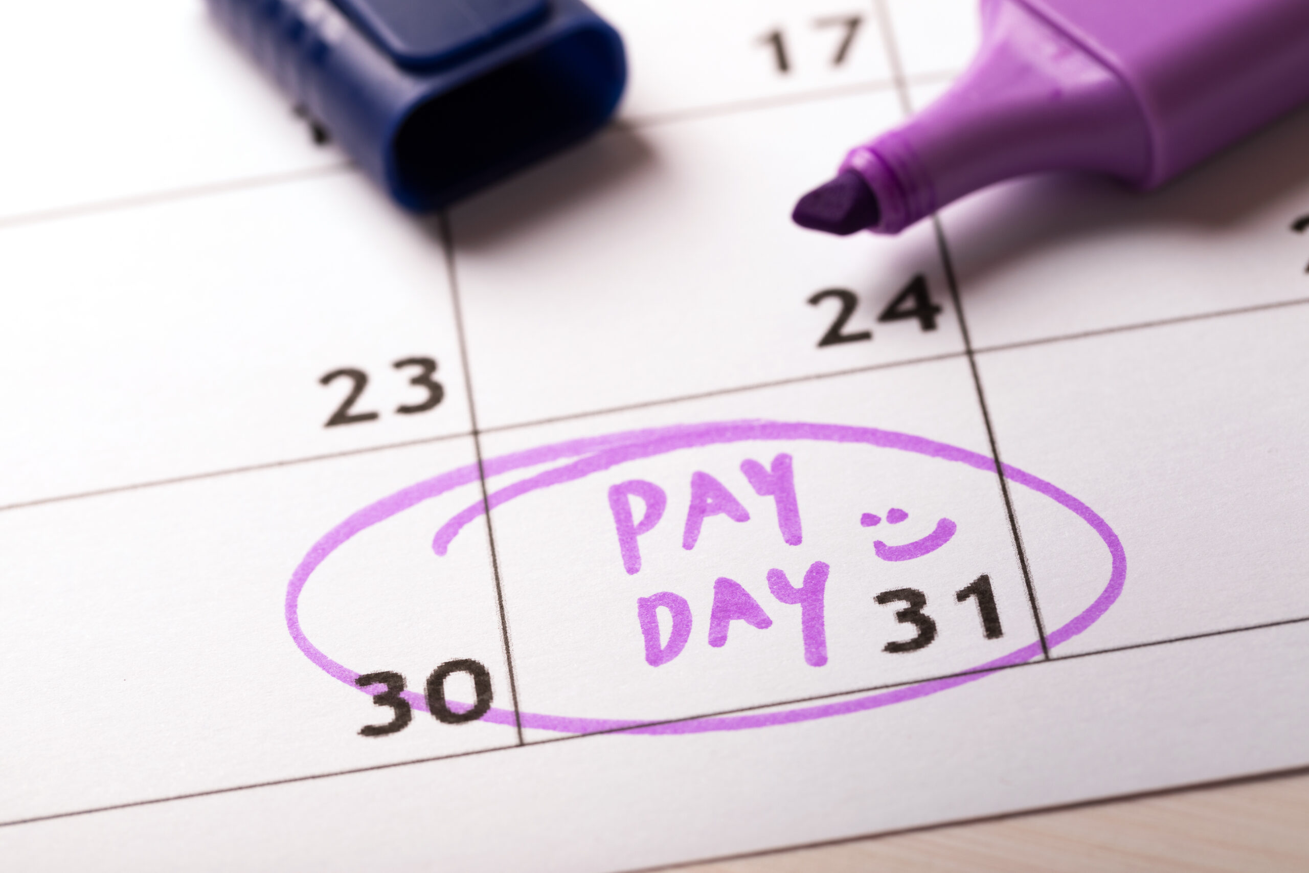 pay day written on a calendar